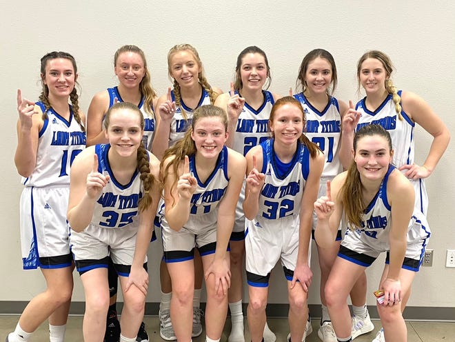 The Lubbock Titans girls basketball team secured a 48-42 win over the Dallas Thunder for the Red River District championship Thursday in Round Rock.