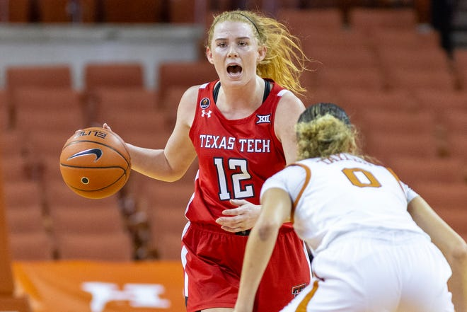 Texas Tech's Vivian Gray dribbles the ball while defended by Texas guard Celeste Taylor during a Big 12 Conference game, Saturday, Jan., 30, 2021, at the Frank Erwin Center in Austin. [Stephen Spillman/Provided Photo]