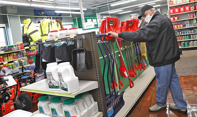 Bernie Malin of East Braintree shops for a shovel and snow removal supplies.
