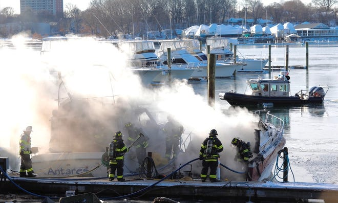 Firefighters work to extinguish a fire at The Clipper Marina, 75 Palmer St., Quincy on Sunday morning.