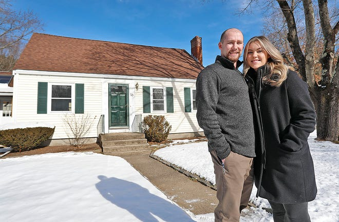 Engaged couple Matt Rakoski and Paige Lambert outside their first home in Rockland on Sunday, Jan. 31, 2021.