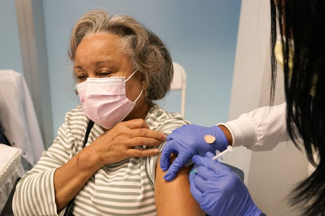 Irma Mesa, 74, receives the Pfizer COVID-19 vaccine at Jackson Hospital in Miami on Wednesday.