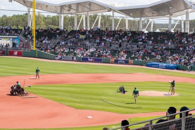 Fans file out of JetBlue Park in Fort Myers, Fla., after a spring training game in 2019. Under an MLB proposal, spring training would be pushed back one month, the regular season's opening day would be delayed to April 28 and the season would be cut from 162 games to 154.