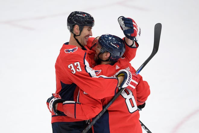 Washington Capitals defenseman Zdeno Chara (33) and left wing Alex Ovechkin (8) celebrate after an NHL hockey game against the Boston Bruins, Saturday, Jan. 30, 2021, in Washington. The Capitals won 4-3 in overtime.