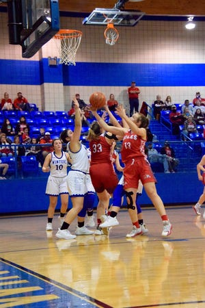 The traffic under the basket was intense as both the Miles Lady Bulldogs and Winters Lady Blizzards played on Friday night.