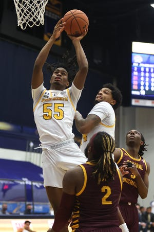 Kent State junior guard James Jordan scores in the first half of Saturday's battle with Central Michigan at the M.A.C. Center.