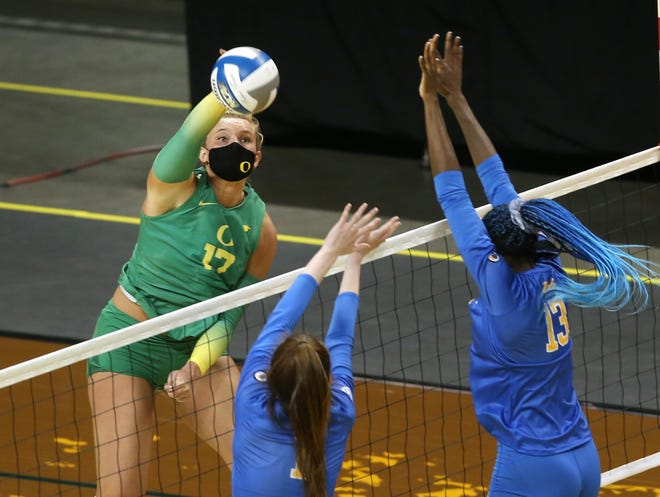 Oregon's Taylor Borup, left, seen in a Jan. 31 home match against UCLA, had 11 kills and 12 digs in Friday's win over Oregon State.