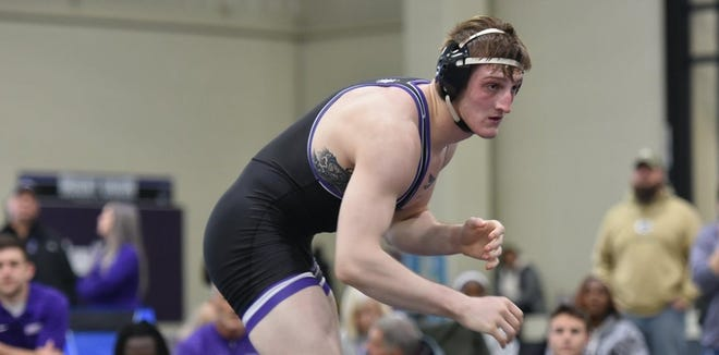 Mount Union wrestler David Reinhart recorded a pin in Sunday's season-opening win over Heidelberg (Photo: University of Mount Union Athletics)
