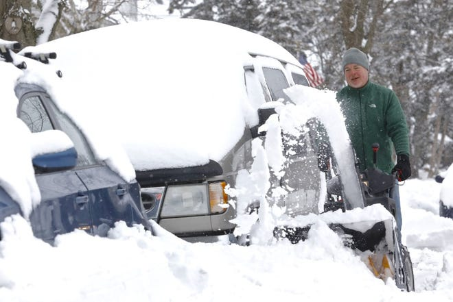 More snow, followed by a cold snap, is headed toward the Freeport and Rockford region this week and weekend. In this image from Sunday, Dan Wilkins works to dig cars out from underneath snow in Rockford.