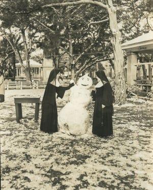 Two nuns build a snowman on the  Plaza de la Constitucion in St. Augustine in February 1951.