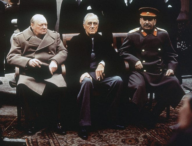 This Feb. 4, 1945, photo shows, from left, British Prime Minister Winston Churchill, President Franklin Roosevelt and Soviet Premier Josef Stalin as they sit on the patio of Livadia Palace, Yalta, Crimea. Initially hailed as a major success, the conference later came to be viewed by some as the moment that the U.S. ceded too much influence to the Soviets and the trigger for the Cold War.