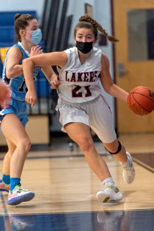 Apponequet's Abbey Lens makes a baseline drive to the basket while Seekonk's Lauren Tortolani defends last Tuesday in South Coast Conference action. Seekonk took the win, 53-32. The Lakers have since won two straight over Wareham and Case for a 5-2 record to start the week.