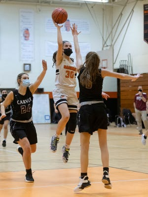 Middleboro's Riley Griffin drives and shoots over Carver's Jordan Vitale Friday night during a 56-27 win at the Joe Masi Gym.