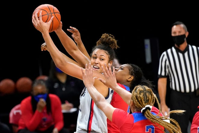 UConn's Olivia Nelson-Ododa is pressured by DePaul's Deja Church (3) and Darrione Rogers during the first half of an NCAA college basketball game Sunday, Jan. 31, 2021, in Chicago.