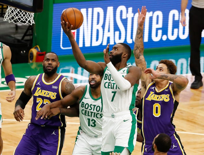 The Celtics' Jaylen Brown (7) goes to the basket as Lakers forward LeBron James, left, looks on during the second quarter Saturday night at TD Garden.