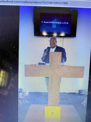 Bishop James Dixon Jr., senior pastor of Greater Faith Baptist Fellowship, delivers a message of hope on Sunday.
