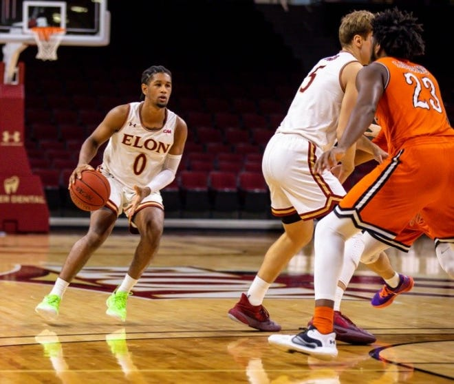 Elon's Hunter McIntosh, left, looks to launch a shot last month during a victory against Campbell.