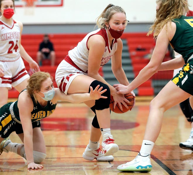 Kimberly's Brooke Ellestad (22) drives to the basket against Beaver Dam's Natalie Jens (1) and Kylie Wittnebel (5) during their game on Jan. 30.