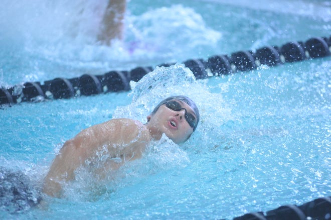 Colonel Crawford's Jacob Awbrey swims the 100 freestyle at the NCOSL meet.