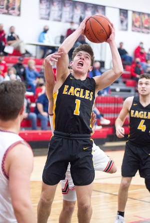 Colonel Crawford's Mason Studer powers to the basket.