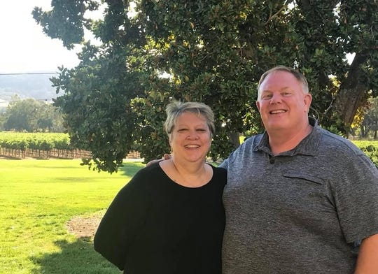 Lois Vidimos, left, and her husband Robert Vidimos II, right, in this undated photo. Vidimos II was a correctional officer at the Iowa Correctional Institution for Women. He died Nov. 16 from complications from COVID-19.
