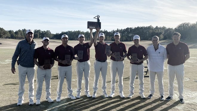 Members of the Florida State golf team celebrate their victory at the 2021 Camp Creek Seminole Invitational.