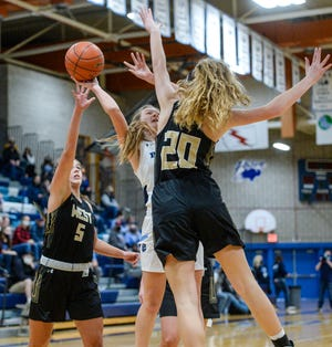Great Falls High's Hallie Thompson attempts a shot as Billings West's Bella Murphy, no. 5, and Kendell Ellis, no. 20, defend in Saturday's basketball game in the Swarthout Fieldhouse.