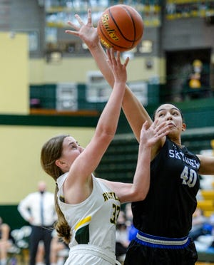 CMR's Natalie Bosley attempts a shot as Skyview's Breanna Williams defends during Saturday's basketball game in the CMR Fieldhouse.