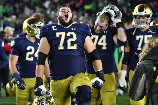 Oct 12, 2019; South Bend, IN, USA; Notre Dame Fighting Irish offensive lineman Robert Hainsey (72) celebrates after Notre Dame defeated the USC Trojans at Notre Dame Stadium.