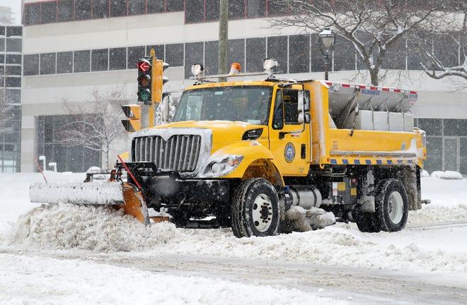 A City of Milwaukee snow plow clears East Kilbourn Avenue Sunday in Milwaukee.