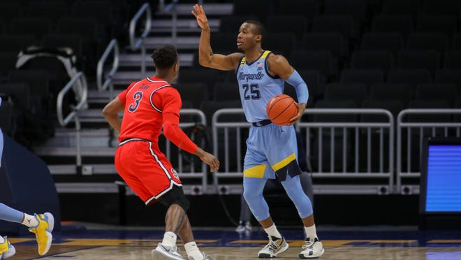 Koby McEwen transferred to Marquette from Utah State.