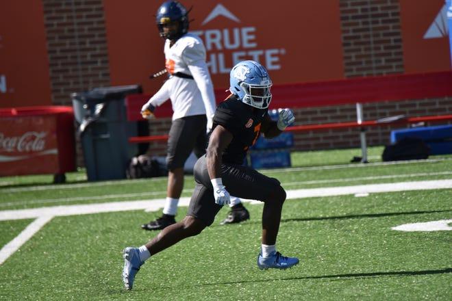 Former North Carolina and Navarre star Michael Carter participates in practice at the 2021 Senior Bowl in Mobile, Alabama.