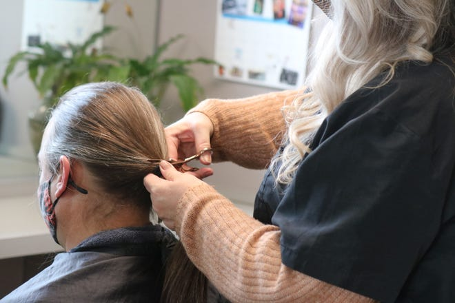 After vowing not to until the team had a winning season, longtime Cleveland Browns fan Jeff Panovich finally got his hair cut on Saturday by his friend Kristy Fullenkamp, of Making Waves in Sandusky.