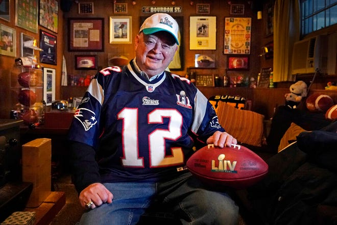 Don Crisman poses at his home, Wednesday, Jan. 27, 2021, in Kennebunk, Maine. Crisman is one of three fans who have attended every Super Bowl. This year the trio will have to work coronavirus-era precautions into the trip. (AP Photo/Robert F. Bukaty)