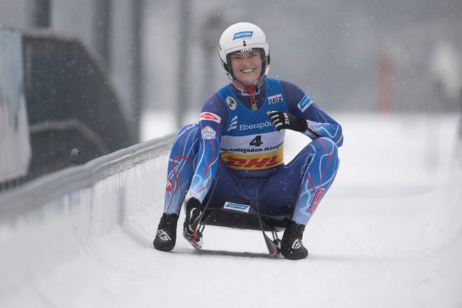 Summer Britcher of USA celebrates in the finish area after the women's race at the Luge World Championships in Koenigssee, Germany, Sunday Jan. 31, 2021. (AP Photo/Andreas Schaad)