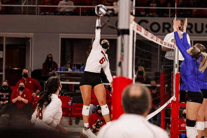 South Dakota's Elizabeth Juhnke goes up for a hit against No. 14 Creighton on Sun., Jan. 31, 2021 at the Sanford Coyote Sports Center in Vermillion.