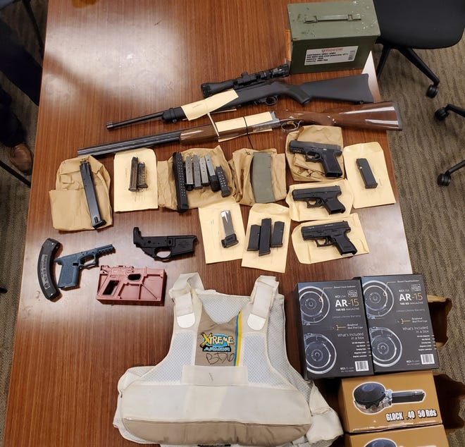 Detectives found numerous illegal guns, ammunition and a bullet proof vest at Danni Cuevas' home on Thursday, January 28, 2021.