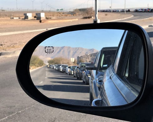 Drivers line up recently to enter the COVID-19 vaccination site at 301 George Perry Blvd in ElPaso. The wait was over 3.5 hours long and the line of vehicles stretched out for more than 2 miles.