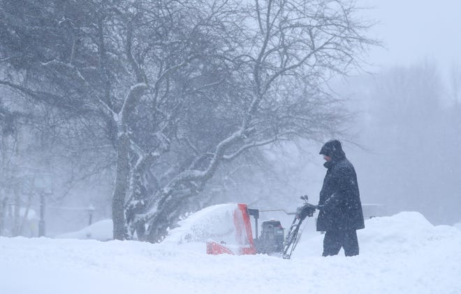 Joel Berman uses a snowblower to clear his driveway Jan. 31 in Bayside, Wis.