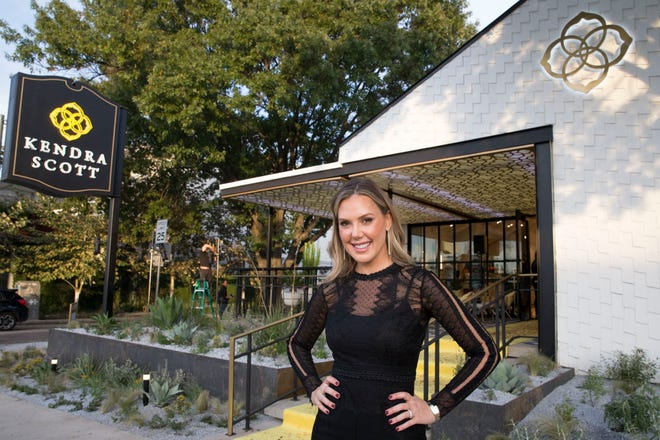 Kendra Scott stands outside her company's flagship store on South Congress Avenue in Austin in 2018.