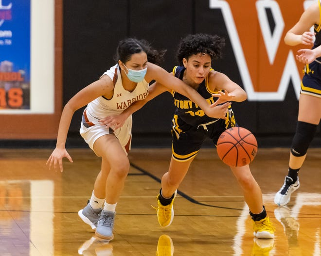 Ariano Rosado, right, picks up a steal for Stony Point against Westwood's Serena Barauah and goes on to score on a breakaway. Stony Point won a district girls basketball game at Westwood 63-36 on Jan. 29.