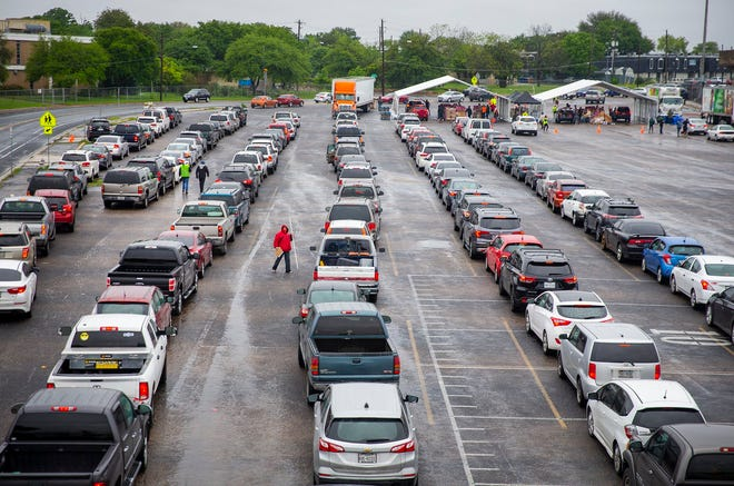More than 3,000 vehicles made their way to the parking lot of Nelson Field at Reagan Early College High School to pick up to a 30-pound box of food in April. The Central Texas Food Bank hosts another food giveaway Thursday at the Travis County Expo Center.
