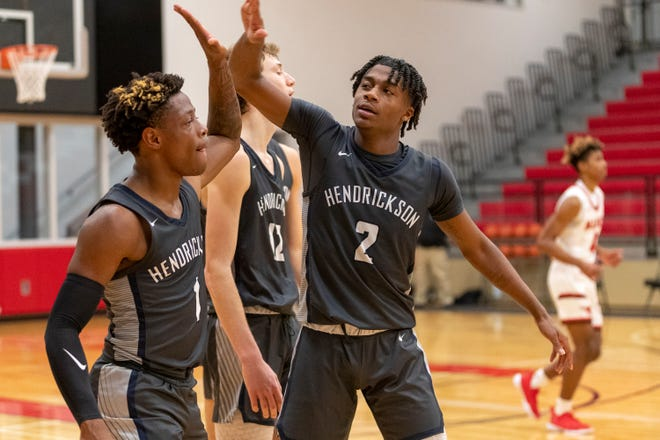 Hendrickson guard Jaden Williams, left, and guard Keshawn Williams celebrate a 66-62 win over Manor during a District 18-5A game in January. The two district favorites meet again this week.