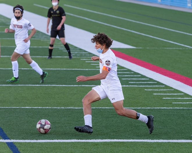 Luca Cipleu, moving the ball upfield for Westwood in a match against St. Stephen's earlier this season, helped the Warriors go 2-0 last week in District 25-6A play with a pair of 3-0 wins over Vista Ridge and Hutto.