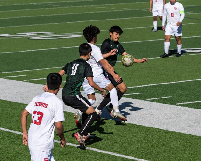 Connally defender Gabry Olaldem right, battles for the ball in a game against East View earlier this season. Connally split a pair of district matches last week.