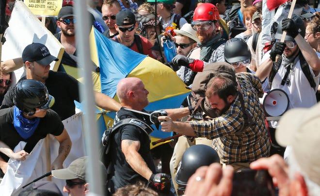 White nationalist demonstrators clash with counter demonstrators in Charlottesville, Va., in 2017.  [AP Photo/Steve Helber]