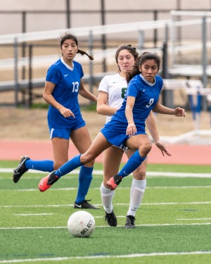 Isela Ramirez, dribbling the ball against Cedar Park earlier this season, scored two goals as the state-ranked Pflugerville girls soccer team shut out Elgin 5-0 Friday to improve to 2-0 in District 18-5A and 7-2 on the season.