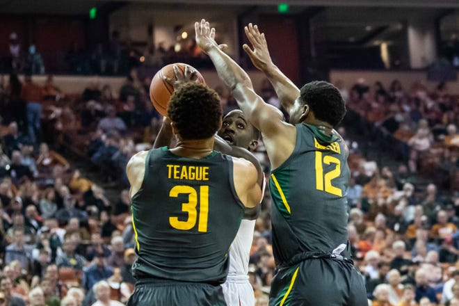 Texas' Courtney Ramey is blocked by Baylor's Macio Teague and Jared Butler during last season's game in Austin. The Longhorns and Bears are both ranked in the top 10 entering Tuesday's game; the Bears have won nine of the last 10 meetings.