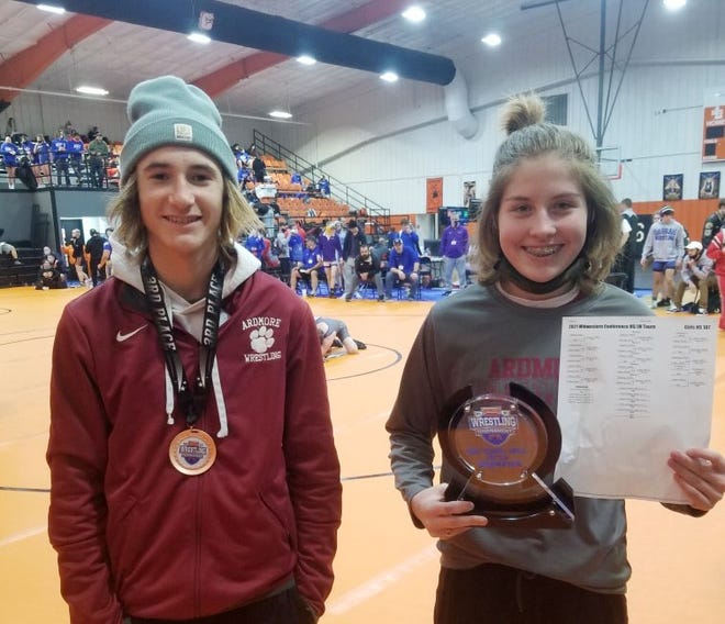 Ardmore's Adyson Lewis, right, tallied four wins Saturday to take first place at the Midwestern Conference Tournament. Cameron Orr also medaled with a third-place finish at 106 pounds.