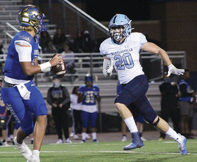Bartlesville High School linebacker Rocky Shuman, right, pressures the Choctaw High quarterback during 2020 season play.